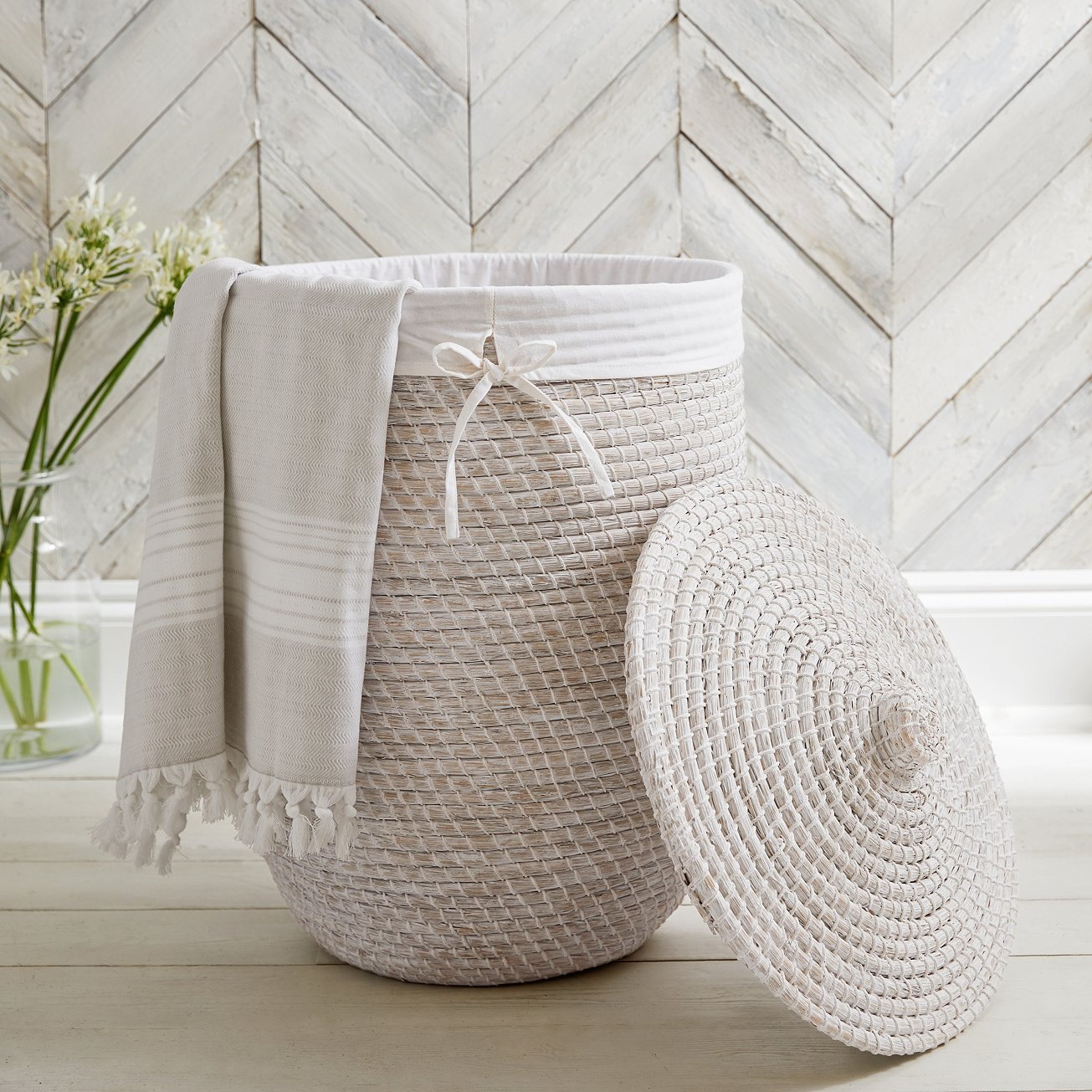 The Hand woven seagrass laundry basket is a best seller and is handmade in Vietnam. The basket has a matching lid and removable cotton liner to make transferring to your washing machine easier. - £165.00